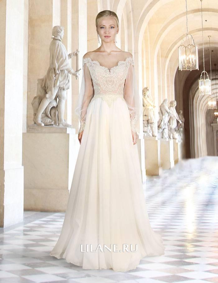 Прямое свадебное платье Jasmin цвета шампанского с полупрозрачными рукавами декорировано кордовым кружевом