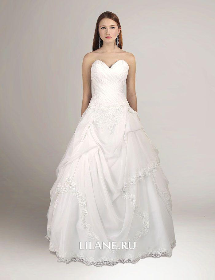 Ассиметричная драпировка плавно переходящая в юбку свадебного платья Milli